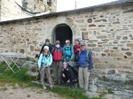 Camino family outside frigid Foncebadon albergue, ready to tackle the walk to Cruce de Ferro