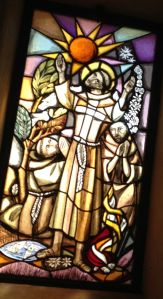 San Damiano window with St. Francis preaching to all creatures.